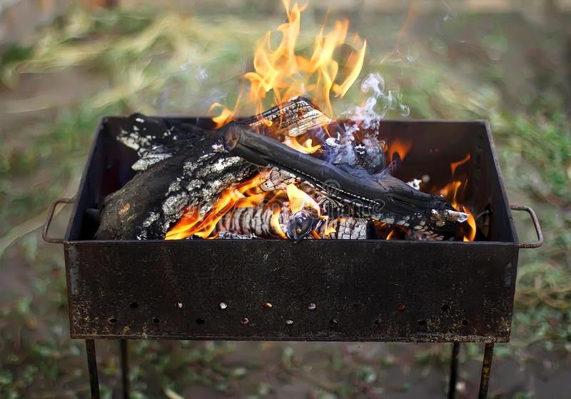 Burning fire for a barbecue outdoors stock photography
