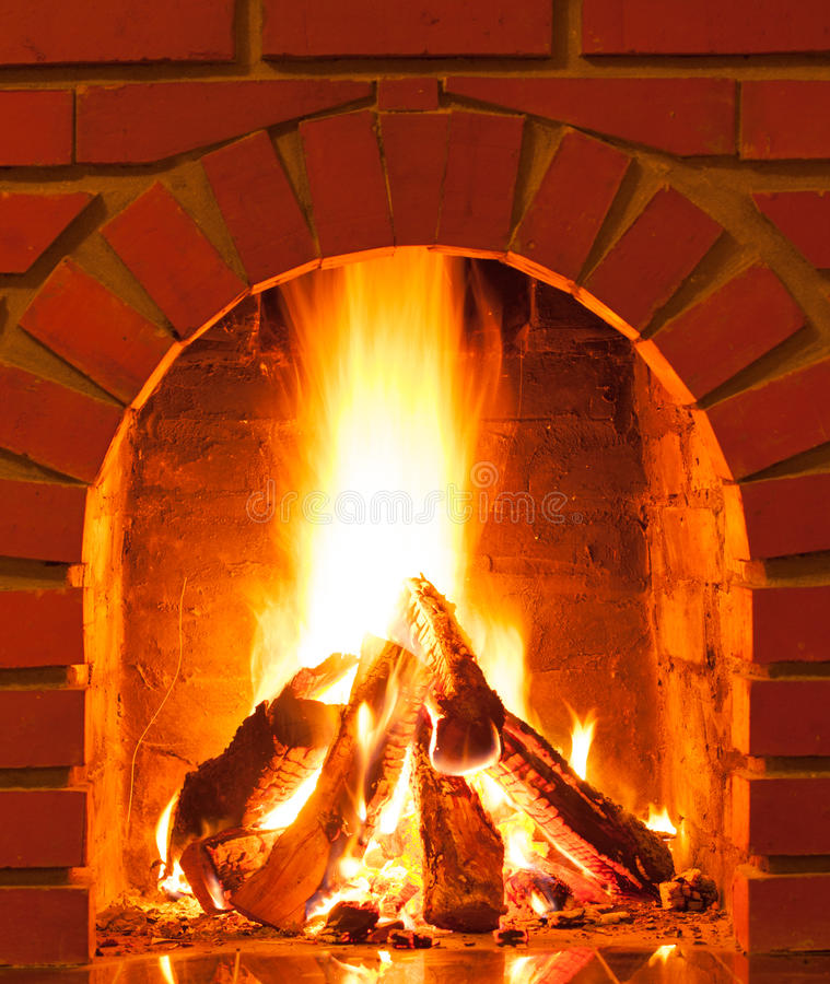 Burning fire. In the brick fireplace, close up stock photo