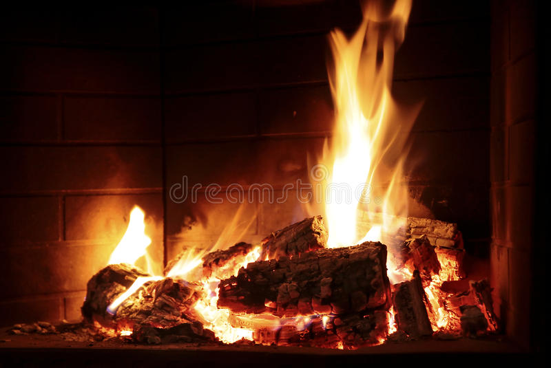 Burning fire in a fireplace stock image