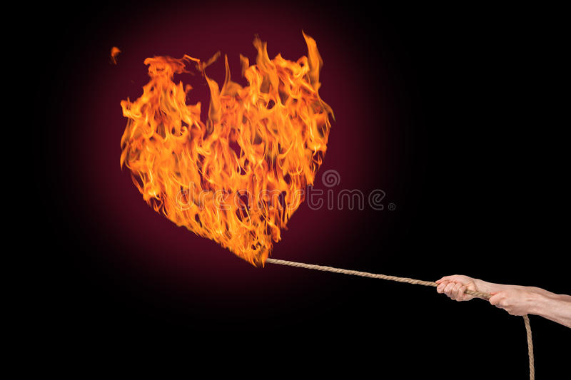Download Burning fire heart stock photo. Image of lights, hand - 23126612
