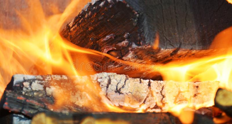 Burning fire, hot flames and oven. Wood dark hard logs burning, orange flames and hot temperature stock photography