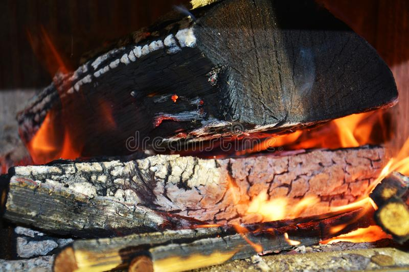 Burning fire, hot flames and wooden oven. Wood dark hard logs burning, orange flames and hot temperature stock image