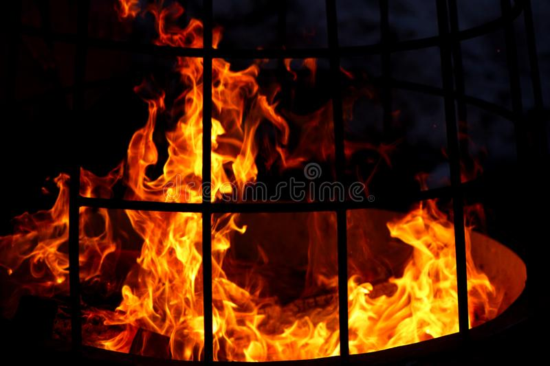 Burning fire in iron street chafing dish close-up. Abstract background royalty free stock images