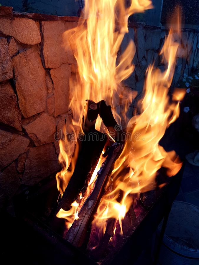 Burning fire. Outdoor burning fire for barbecue in the evening stock image