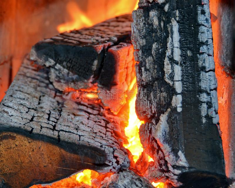 Wood fire. Burning fire wood and ember in stove royalty free stock image