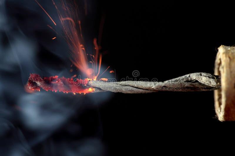 Burning Firecracker. The burning fuze of a firecracker royalty free stock photography