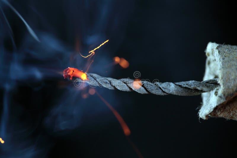 Burning Firecracker. The burning fuze of a firecracker royalty free stock photos