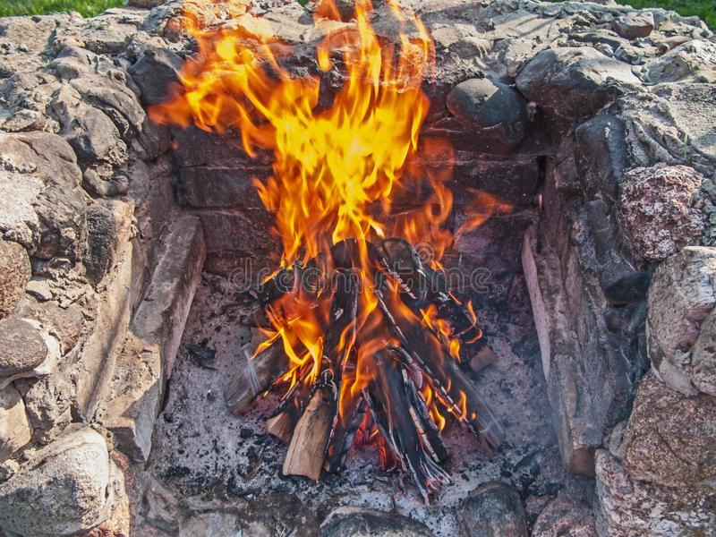 A burning fireplace in a stone hearth. stock images