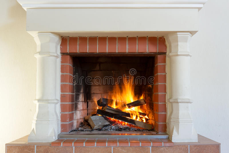 Burning fireplace. royalty free stock images