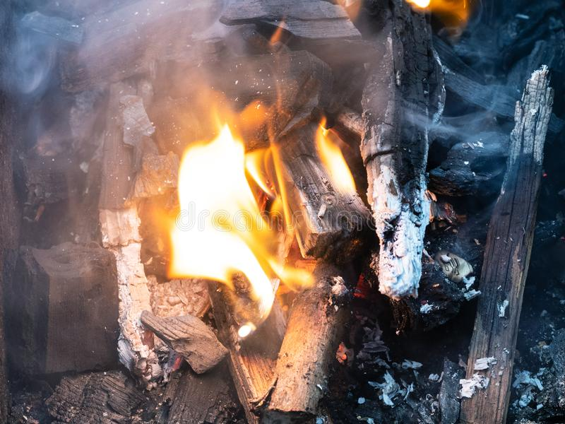 Burning firewood and charcoal close up. In grill stock photos