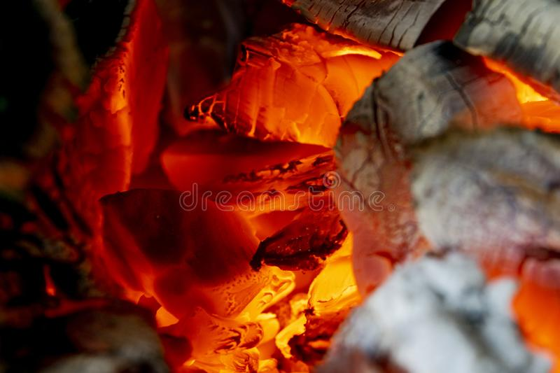 Burning firewood in the fireplace close up, BBQ fire, charcoal background. Charcoal fire with sparks. Fire background. Close up. Burning firewood in the stock photos