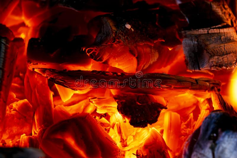 Burning firewood in the fireplace close up, BBQ fire, charcoal background. Charcoal fire with sparks. Fire background. Close up. Burning firewood in the royalty free stock photo