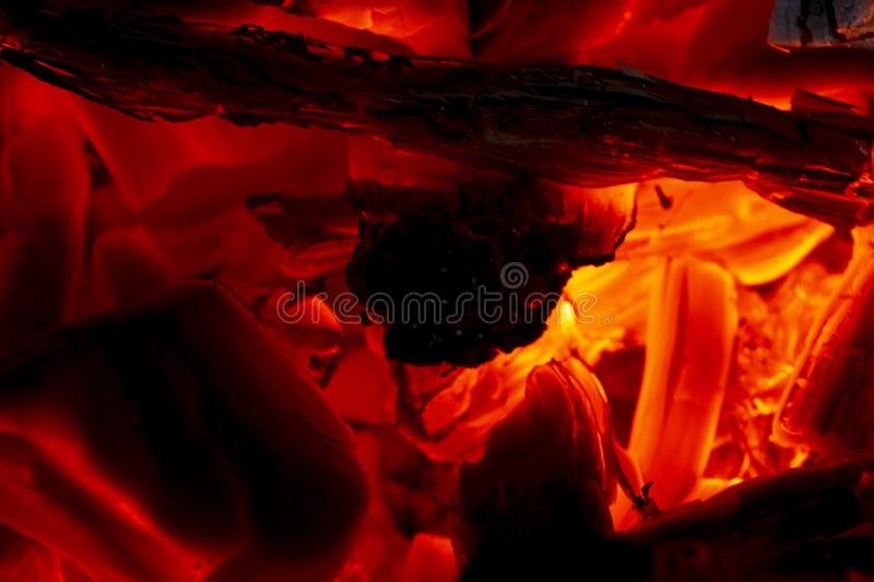 Burning firewood in the fireplace close up, BBQ fire, charcoal background. Charcoal fire with sparks. Fire background. Close up. Burning firewood in the royalty free stock photos