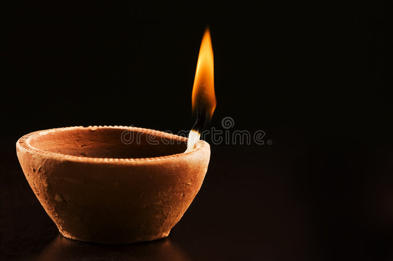 Download Burning Flame In Earthern Lamp Royalty Free Stock Photo - Image: 9279505
