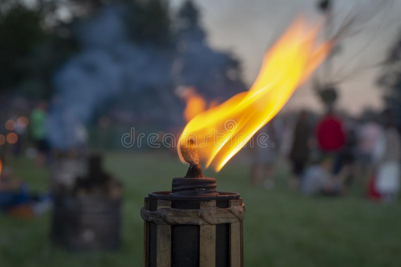 Burning flame of an outdoor torch at a party stock photo