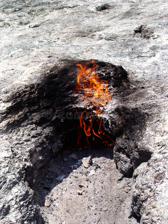 Burning gas out of the ground royalty free stock photography