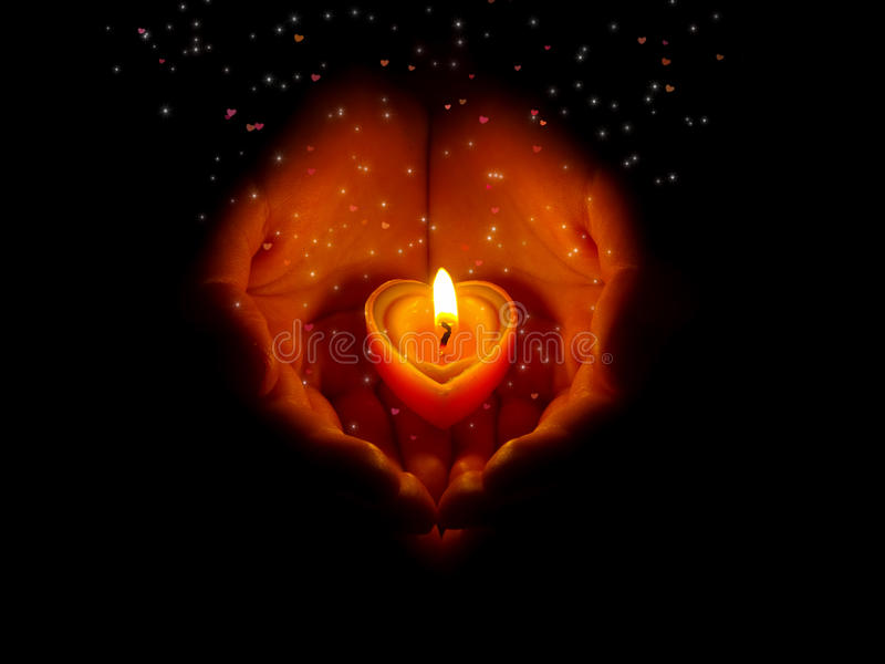 Burning heart on hands. royalty free stock images