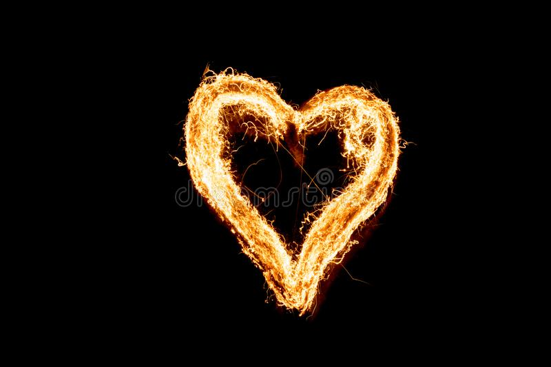 Burning heart, steel wool. Long exposure. Fire threads in the shape of heart stock photos