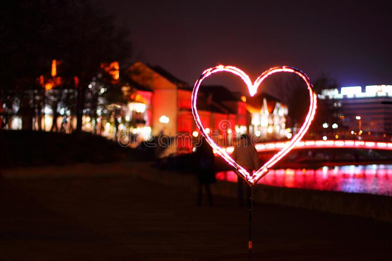 Burning Heart on the Street at Night. Love, Valentine`s Day royalty free stock images