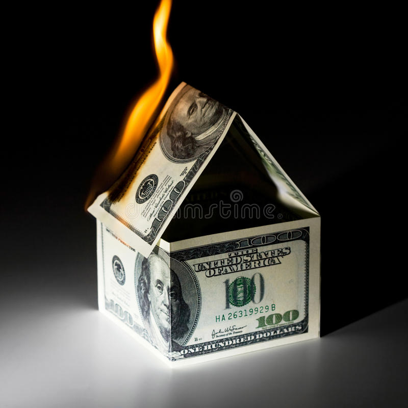 Burning house. Made from dollars royalty free stock images