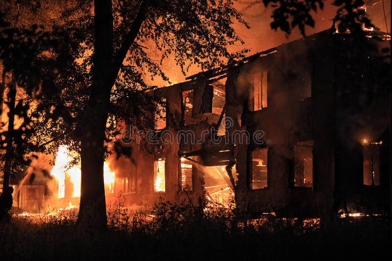 Burning house. In the darkness royalty free stock photography