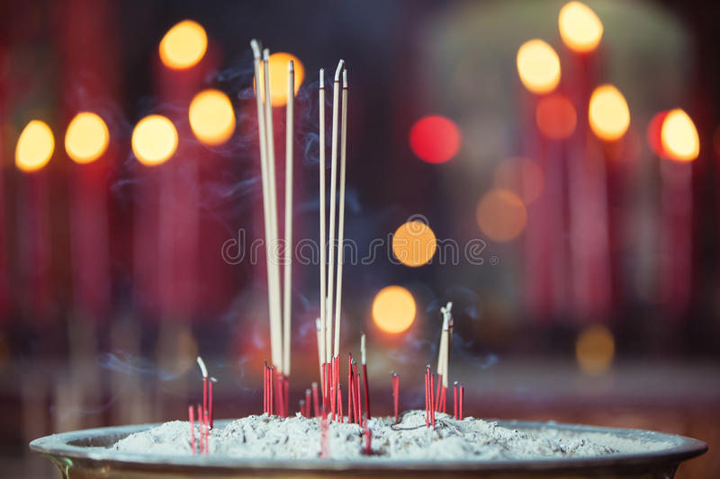 Burning incense in Chinese temple royalty free stock image