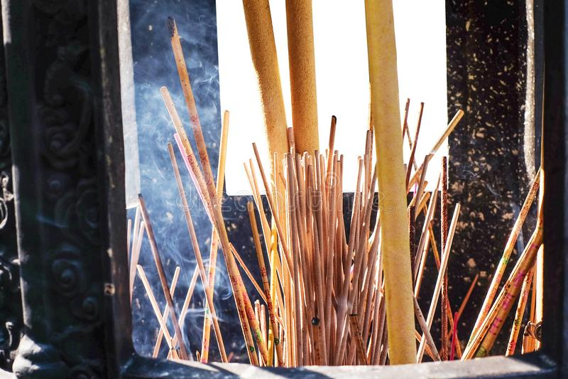 Burning Incense sticks in a big incense po stock images