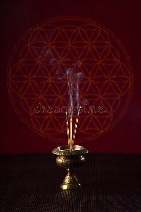 Burning incense sticks stock image