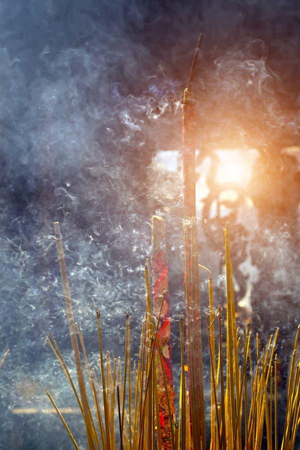 Burning Incense Sticks on joss stick pot with smoke royalty free stock images