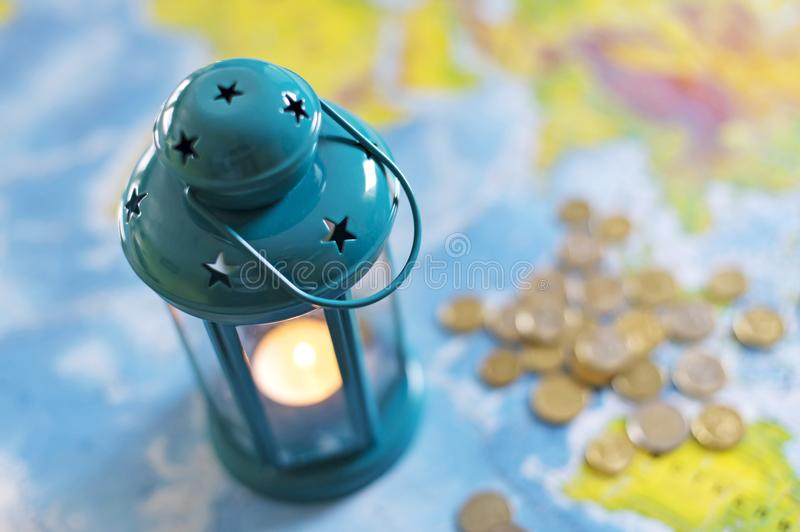 The burning lamp is blue On the map. Inside the lamp, the candle is burning white royalty free stock images