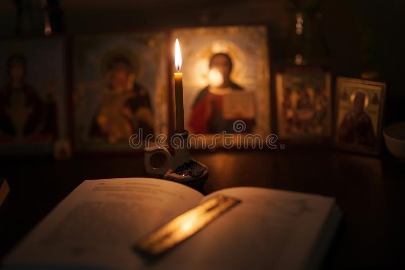 Burning lamp with orthodox icons royalty free stock image