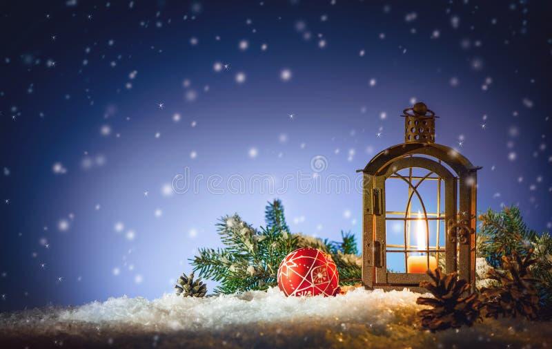 Burning lantern in the snow royalty free stock image