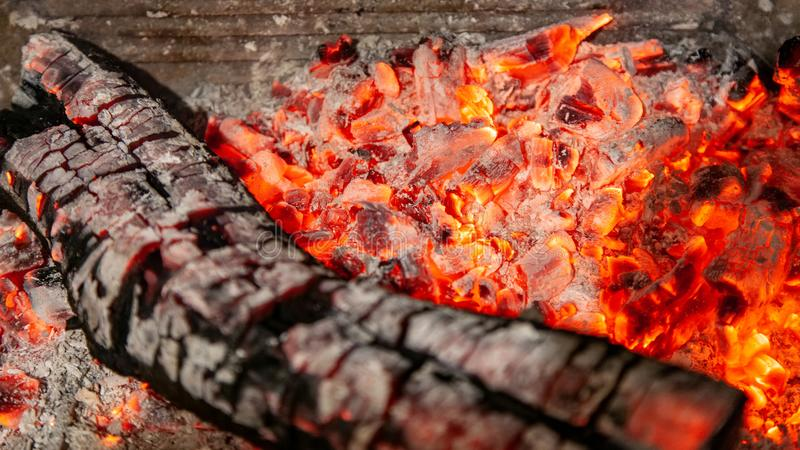 Burning log of wood close-up as abstract background stock photo