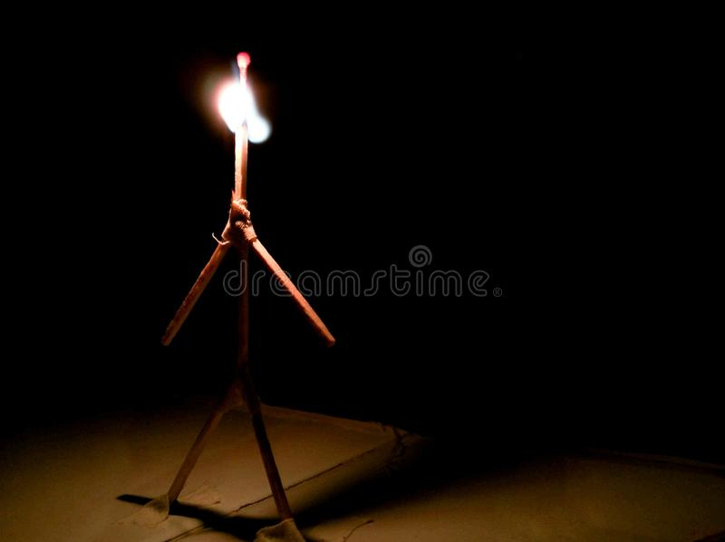 Burning man. Of matches on a black background stock photos