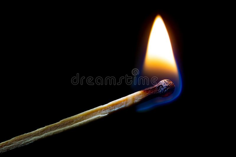 Burning match on black royalty free stock photography