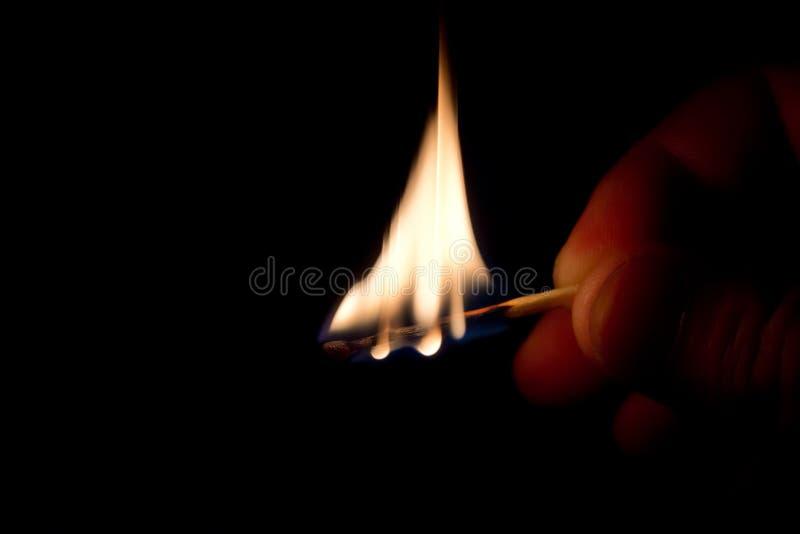 Burning match stock images