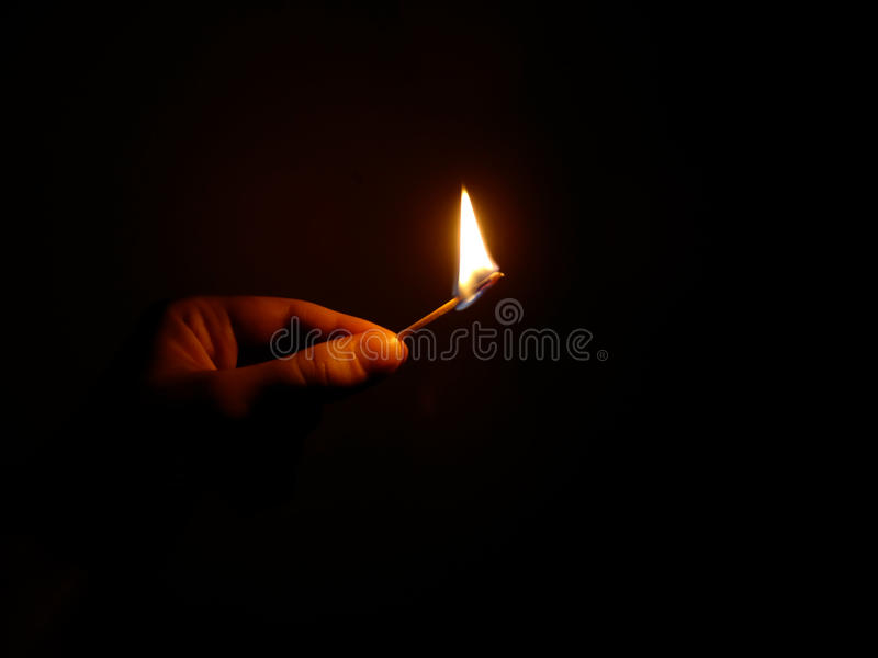 A burning match stock images