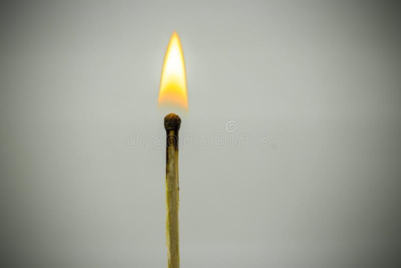 burning match isolated on dark background royalty free stock image