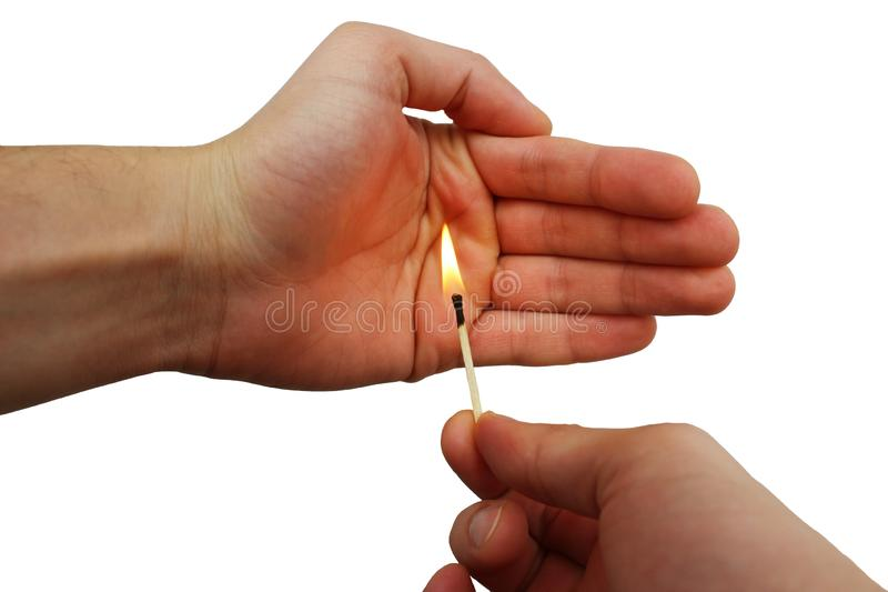 Burning match in a male hands royalty free stock images