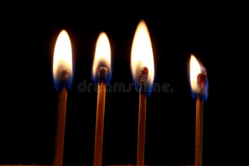 Burning matches on black backgound royalty free stock photo