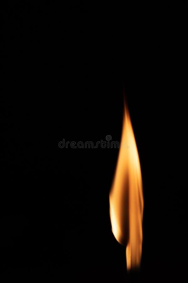 Burning matchstick on black background stock image