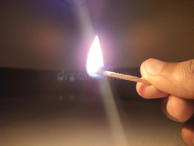 Burning matchstick. royalty free stock images