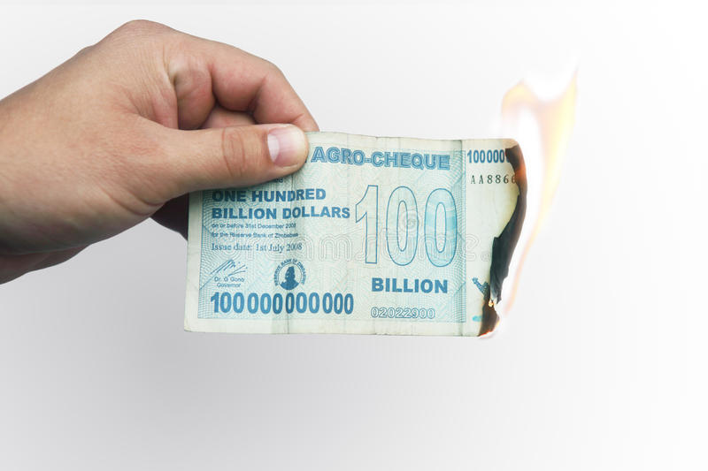 Burning money. Money going up in smoke concept royalty free stock photo