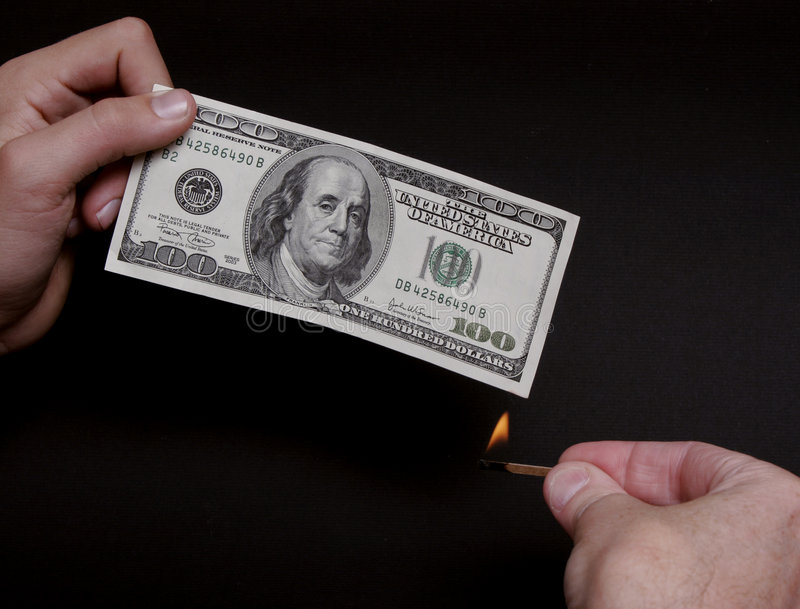 Burning money. Flame by $100 bill royalty free stock images
