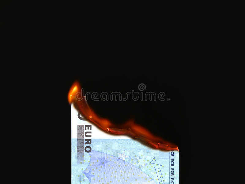Burning money. (Euro) on black background royalty free stock images