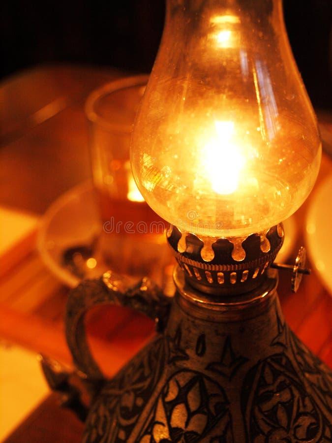 Burning oil lamp stock photo
