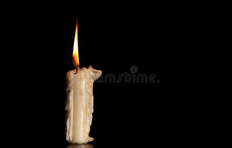 Burning Old Candle on Black Background. royalty free stock images