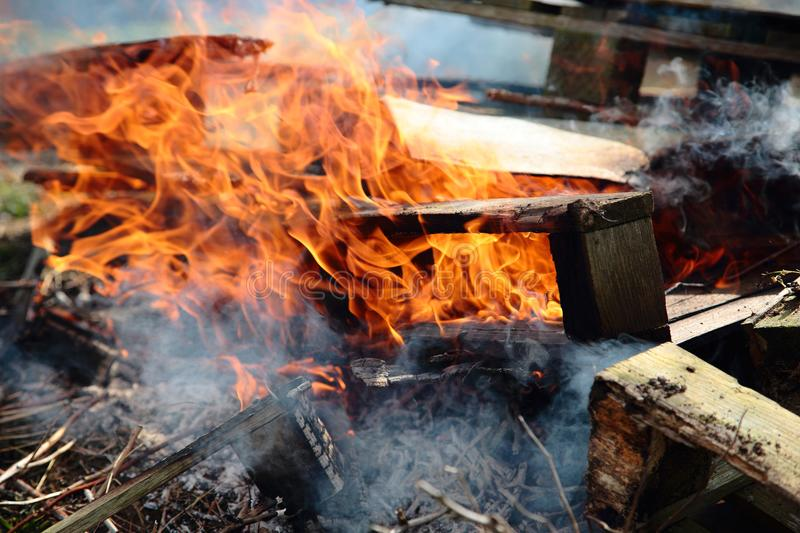 Burning pallets and garden waste on an allotment. With flames taking hold royalty free stock images