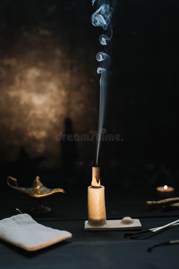 Free Burning Palo Santo Wood Sticks On Black Background. Balancing The Soul. Healing, Meditation, Relaxation And Purifying Concept Stock Photography - 196405692