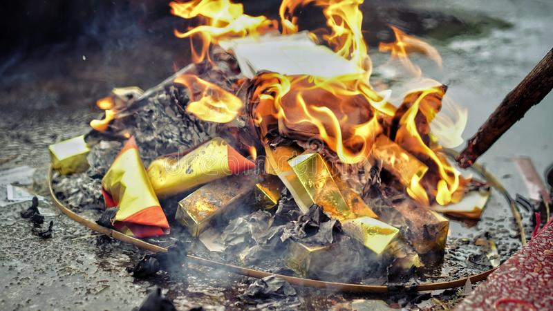 Burning paper for ancestor. Chinese tradition to burn money paper for pass away ancestor. So they can have good life spending money after dead royalty free stock images